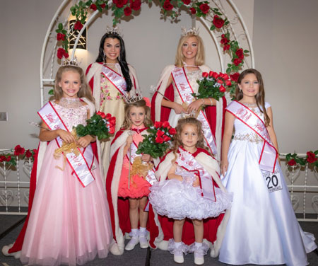Photograph of pageant winners wearing formal gowns.